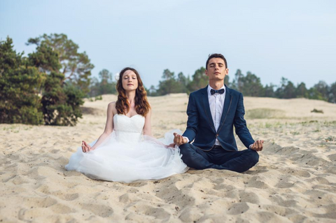 Bride and Groom Meditating