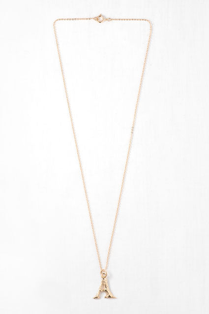 a gold letter necklace