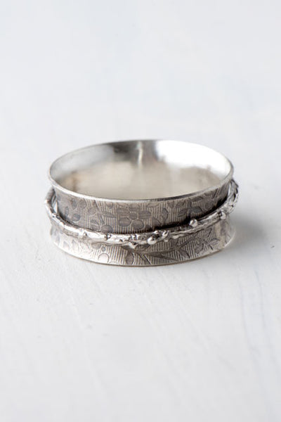 silver flower spinner ring