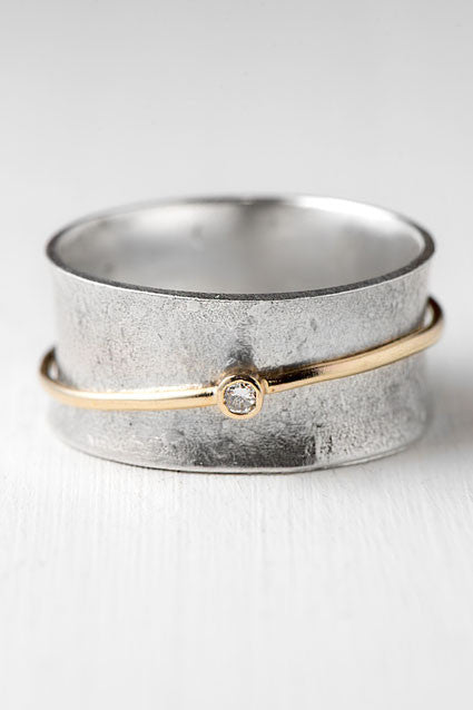 diamond spinner ring with 14k and silver