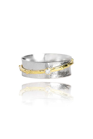 Silver and gold spinner ring with a diamond