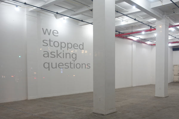 "2017, ""We Stopped Asking Questions,"" New Genres conceptual installation, new media text integrated into photograph taken by the Artist, New York City, 30 x 40 in, 76.2 x 101.6 cm, ADW066"