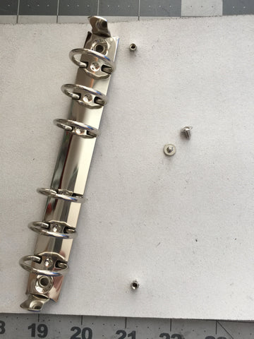 metal binder spine and leather screws