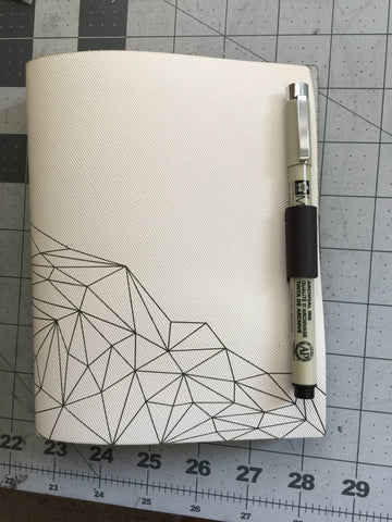 leather journal pen closure