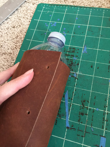 Wrap the leather around the water bottle