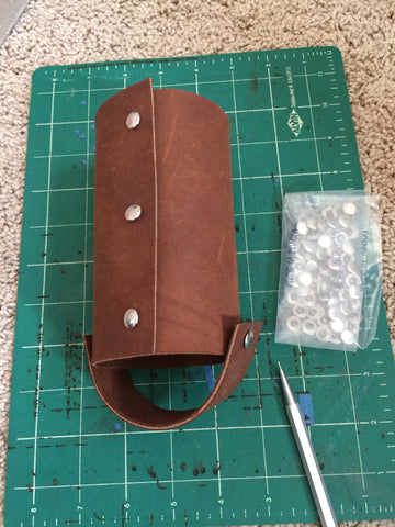 leather water bottle holder with rivets