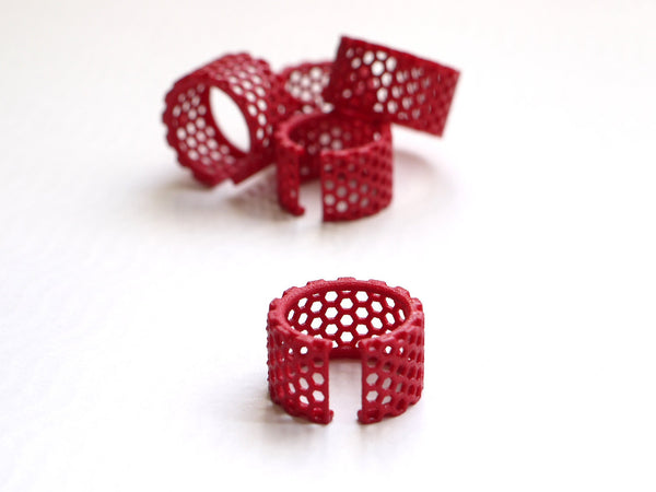3d printed honeycomb ring in red