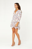 Andria Floral Long Sleeve Dress is the perfect transeasonal piece. Boho dress features v-neckline, long sleeves, adjustable drawstring drop waist, full flared skirt. Floral rayon fabric is non-stretch.