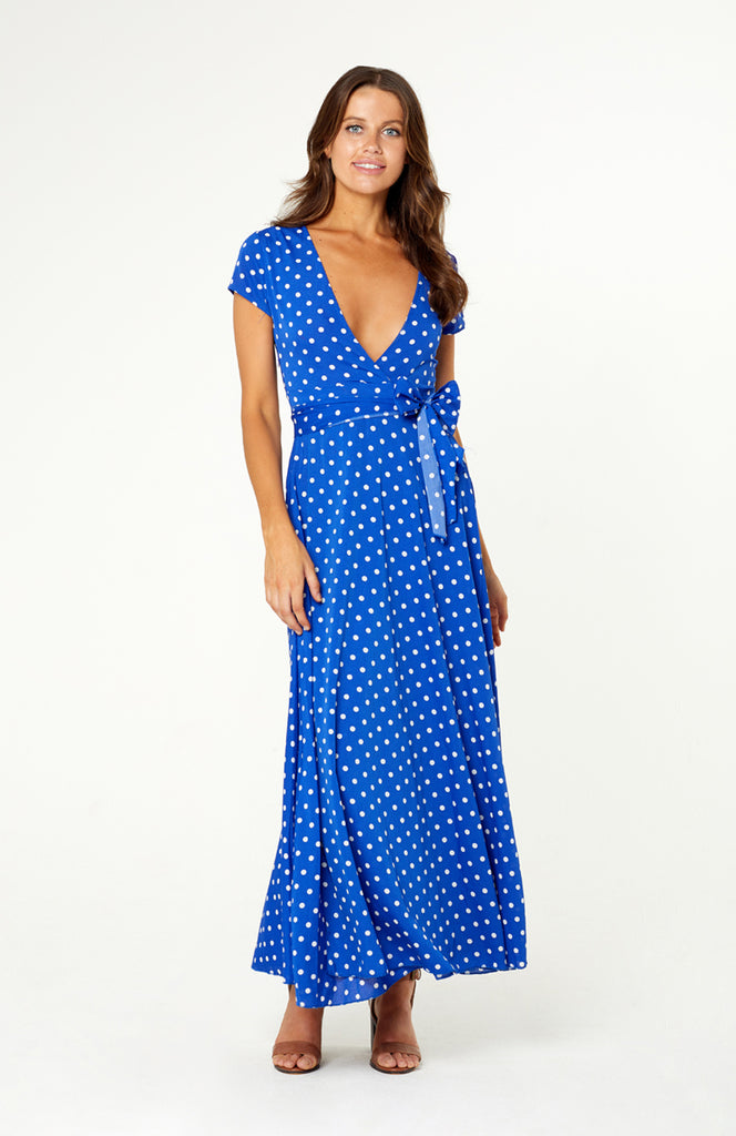 Palermo Palace Wrap Dress, featuring low v-neckline, empire waistline, matching sash around the waistline. Maxi skirt has cross-over details, thigh high slit. Printed polka dot polyester fabric is non-stretch, an invisible zip on side.