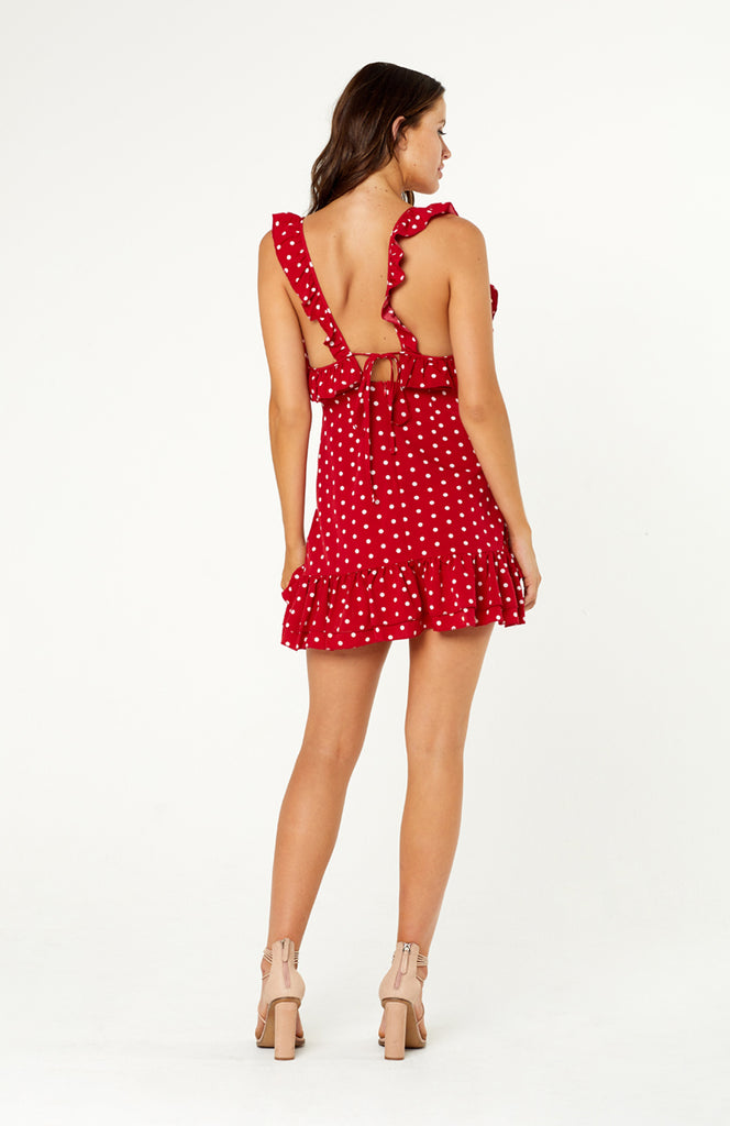 Positano Polka Dot Dres, v-neckline, ruffles from shoulder straps, under the arms, front bodice and hemline. Back of dress has self-tie bow tie detail, hidden zip. Printed polka dot polyester fabric, non-stretch, light weight.