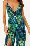 Green palm leaf printed Lovina Leaves Maxi Jumpsuit with deep V-neck, thigh-high splits, self tie waist belt, spaghetti straps and invisible back zip.