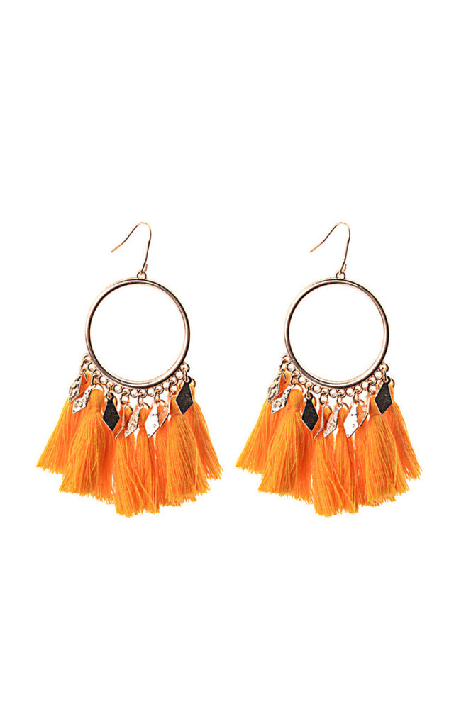 Boho statement drop earrings with gold circle and orange cotton tassels