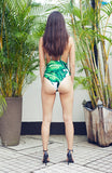 Green and White Palm Printed One Piece Swimsuit with Laddered Side Detail and Low Cut Back