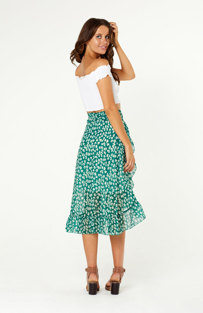 Legian Wrap Skirt features self tie sash, ruffled hemline. Asymmetric skirt, partially lined on inside. Light weight polyester fabric, non-stretch.