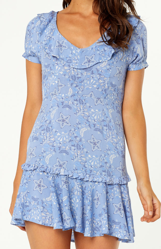 Our Ravello Ruffle Floral Dress features backless lace-up detailing, scoop ruffled neckline, short sleeves, ruffled hemline. Soft cotton rayon fabric is non-stretch, whimsical floral and star print fabric, hidden zip at the back.