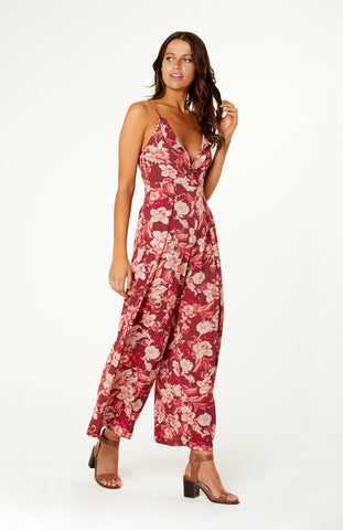 Red Floral Ruffled V Neck Romper, with Adjustable Shoulder Straps, Back Cut Out and Tie-Up Bow, and Wide-Legged Full Length Pants
