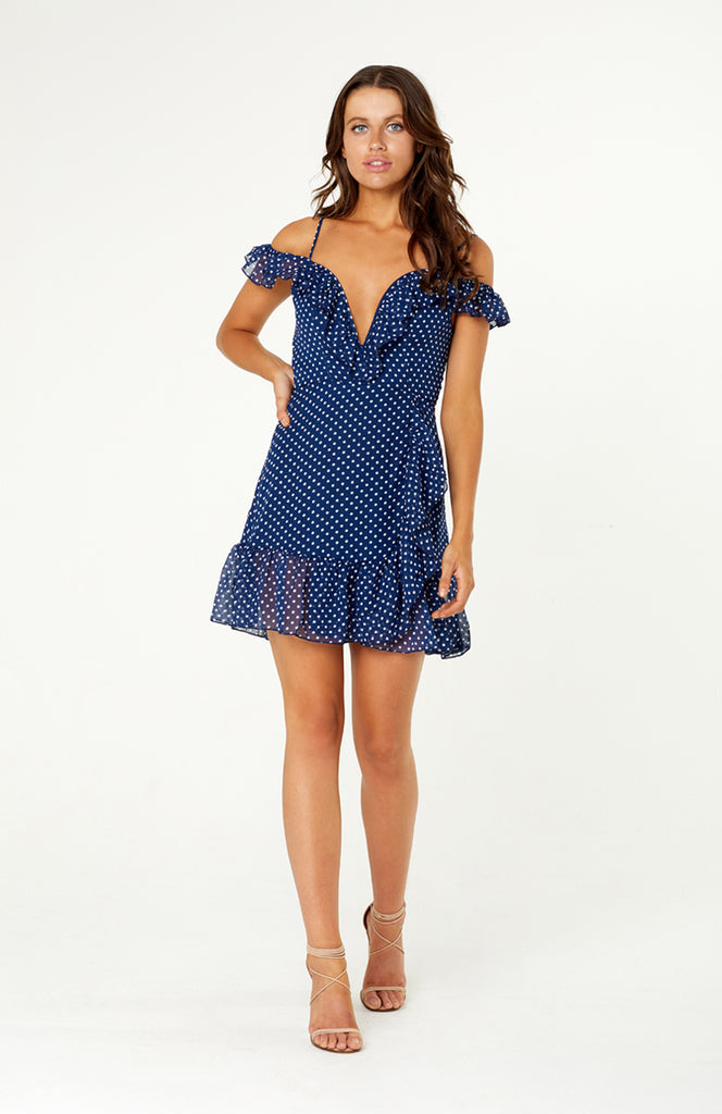 Venice Vacation Dress features v-neck with built-in wire, off shoulder sleeves, adjustable spaghetti straps. Mini dress has split down the left leg with cascading ruffles down the front and around the hemlines. Polka dot chiffon fabric is lined and non stretch with an invisible zip.