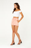 Leighton Linen pink loose fitting high waisted shorts with bow tie sash, pockets and elastic waistband.