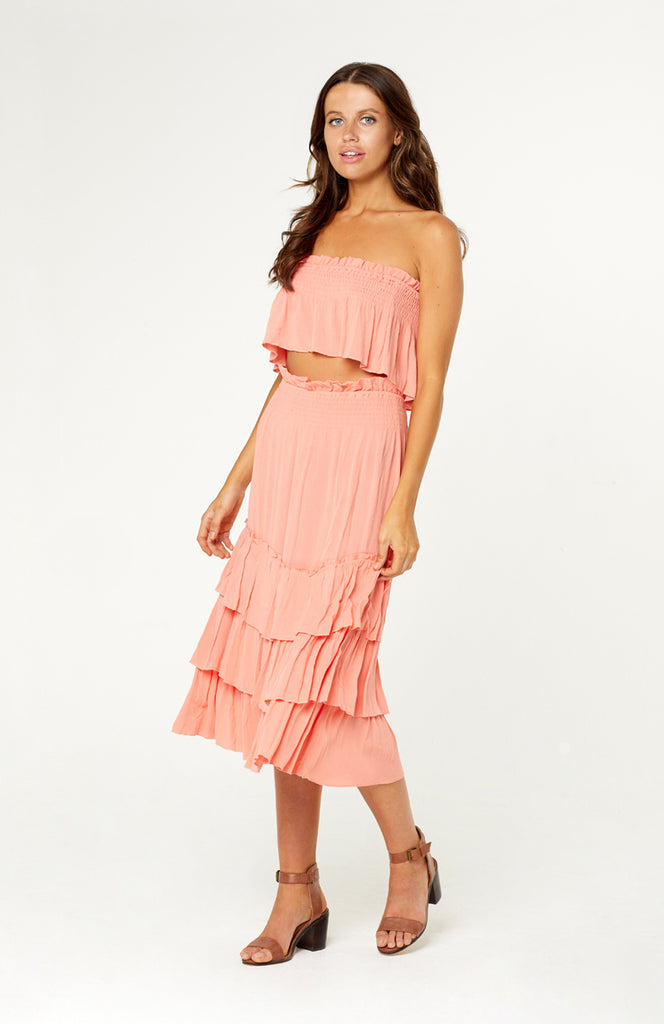 Tanah Two Piece Set, relaxed pink outfit, strapless top and a midi skirt with ruffled tiers. Both top and skirt are elasticised for the perfect fit.