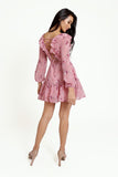 Floral pink mini dress, with a ruffled V-neckline, long lantern sleeves, a full, ruffled hemline and a sexy ruffled lace-up back.