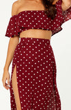 La Plancha Polka Dot Two Piece Set. Features strapless top with off shoulder sleeves, high waisted skirt, two high thigh slits, non-stretch fabric, invisible zip on back of skirt.