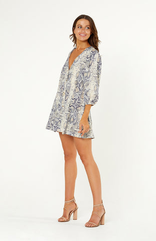 Cefalu Snake Print Shift Dress, v-neckline, four buttons down the front. Three-quarter length lantern sleeves. Snake print poly-satin fabric is light weight and non-stretch.