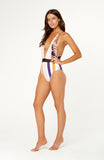 Manarai One Piece Swimsuit features a plunge v-neck, adjustable straps, criss-cross back detail. Bust is not padded and wireless. Stripe and printed fabric.