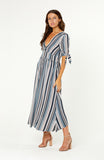 Sicily Stripe Maxi Dress. v-neckline, short sleeves with bow details, buttons down the front and a split at the bottom. Back waist has ruched detailing. Stripe rayon crepe fabric is lightweight and non-stretch