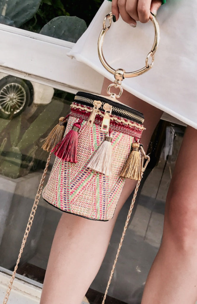 Rattan woven straw bucket hand bag with red tassels and gold handle and chain