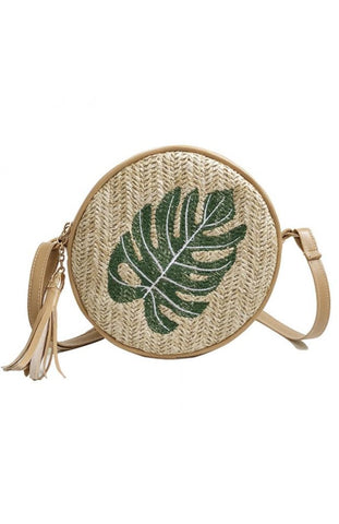 Round straw woven tan beach bag with palm leaf embroidery