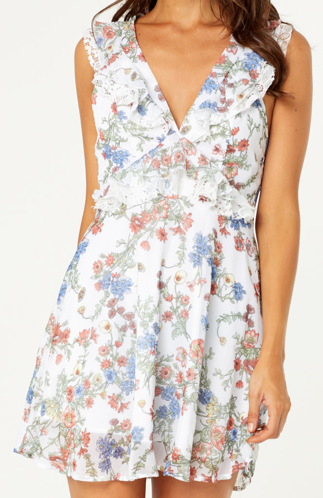 Our Sofia Lace Floral Dress is a backless feminine dress, with low v-neckline complimented by ruffle lace details around the edges and bodice. Adjustable ruffle spaghetti straps with hidden button on back, can worn straight or crossed over. Light weight floral chiffon fabric is lined and non-stretch with hidden zipper.