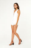 White Bahiana Playsuit Romper, V-neck with eyelet trim detailing, cutout back, elastic waistline with a bow tie and a soft ruffle hemline. The fabric is non-stretch and has no zips.
