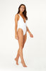 White Tropicola One Piece Swimsuit, ribbed deep plunge neckline, lace up detailing at the front with gold eyelets, cheeky high cut bottom.