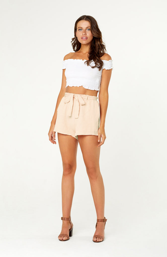 Leighton Linen beige loose fitting high waisted shorts with bow tie sash, pockets and elastic waistband.