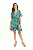 Floral print green V neck dress with butterfly sleeves, and ruffled wrap over skirt