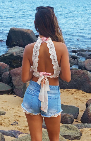 Floral Printed Halter Top with Key Hole Neck Line and Lace and Chiffon Ribbons Ties at the back.