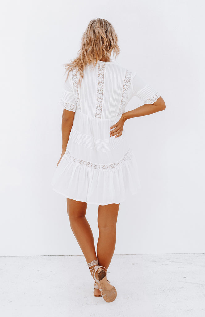 White Lightweight Cotton Empire Line Mini Dress with Short Sleeves, Ruffled Hem, Pleated Details and Embroidery Trim