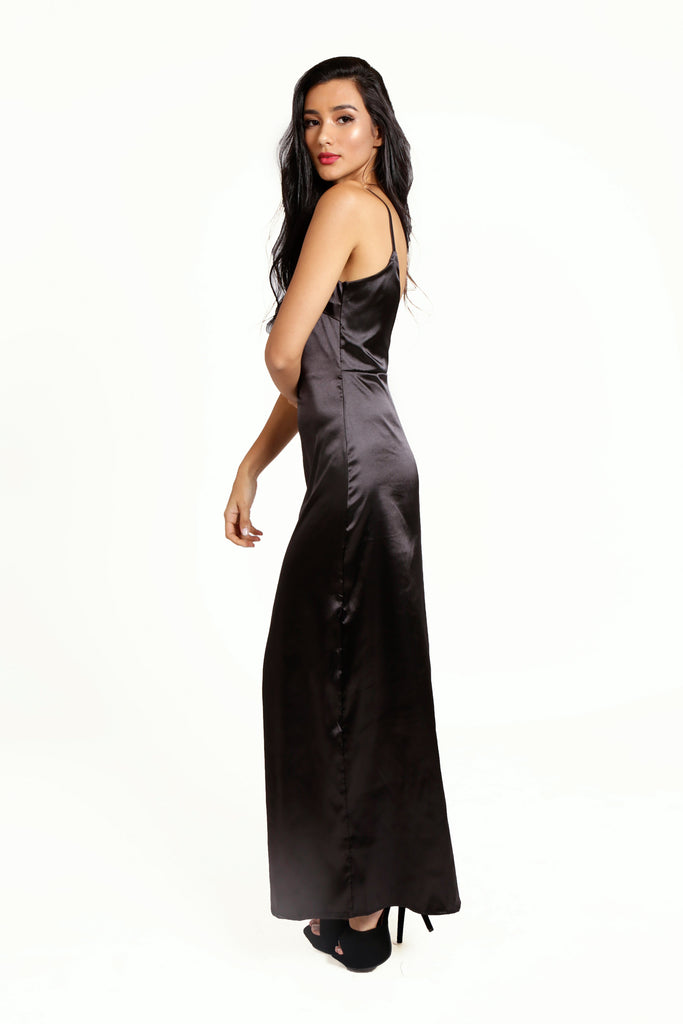 Midnight Madness Maxi Slip Dress, v-neckline, spaghetti straps, low v-back, sexy split up the right leg. Luxe black poly-satin fabric, non-stretch, invisible zip on the side.
