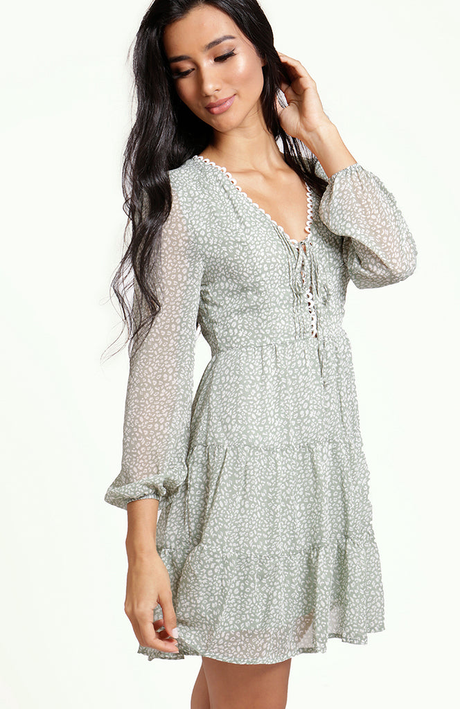 Midori Long Sleeve Dress, featuring v-neckline, white eyelet trim, lace up detailing, soft sheer lantern sleeves and an empire waistline. A-line above the knee dress with tiered skirt. Non-stretch light weight printed fabric lined around the bodice and skirt, invisible zip on the back.