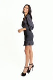 Black and White Printed Satin Mini Dress with Long Sleeves, V neckline, Rouched Skirt with a Ruffled Hem.