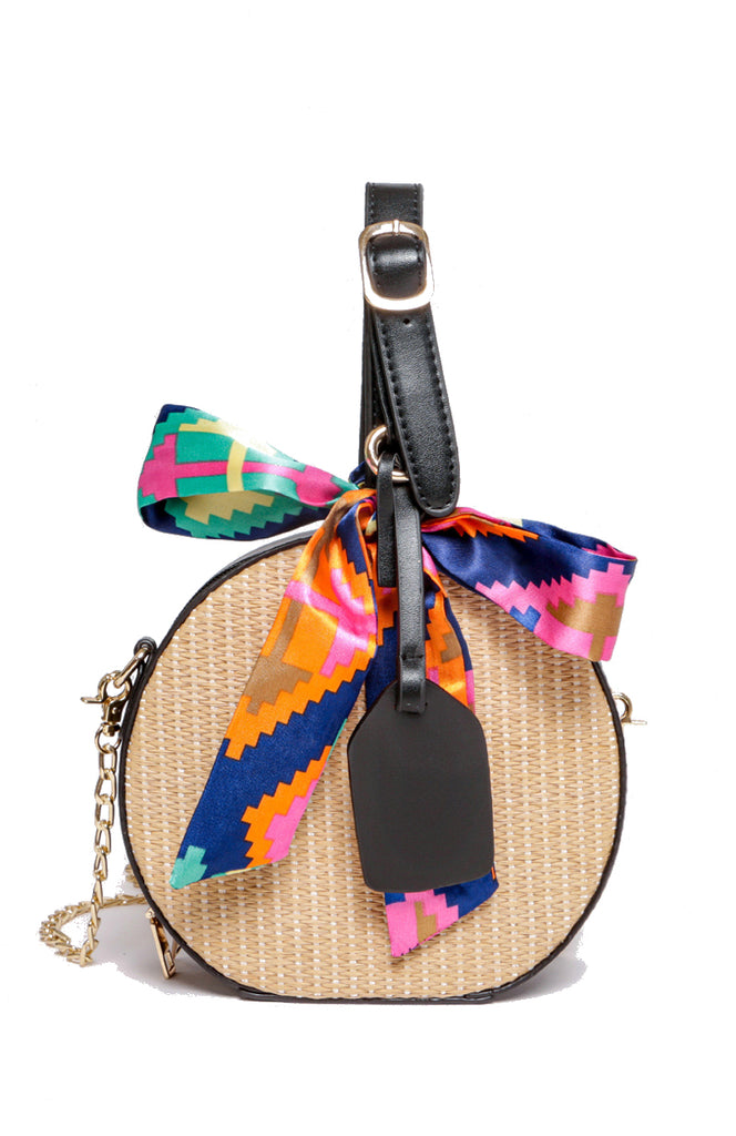 Round straw handbag with black detail, gold chain and satin printed bow sash