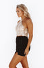 High Waisted Black Suede mini skirt with lace up sides and slit