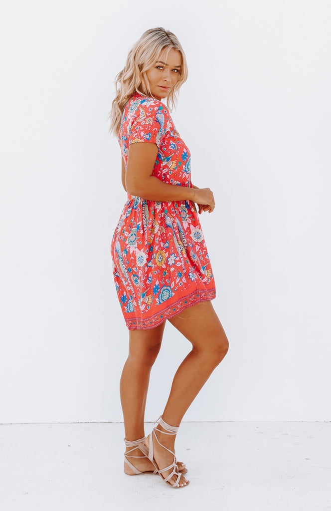 Loose Fit Floral Printed Pink Mini Dress with Short Sleeves, Empire Line Waist, Full Skirt and a V-Neck Button Up Front