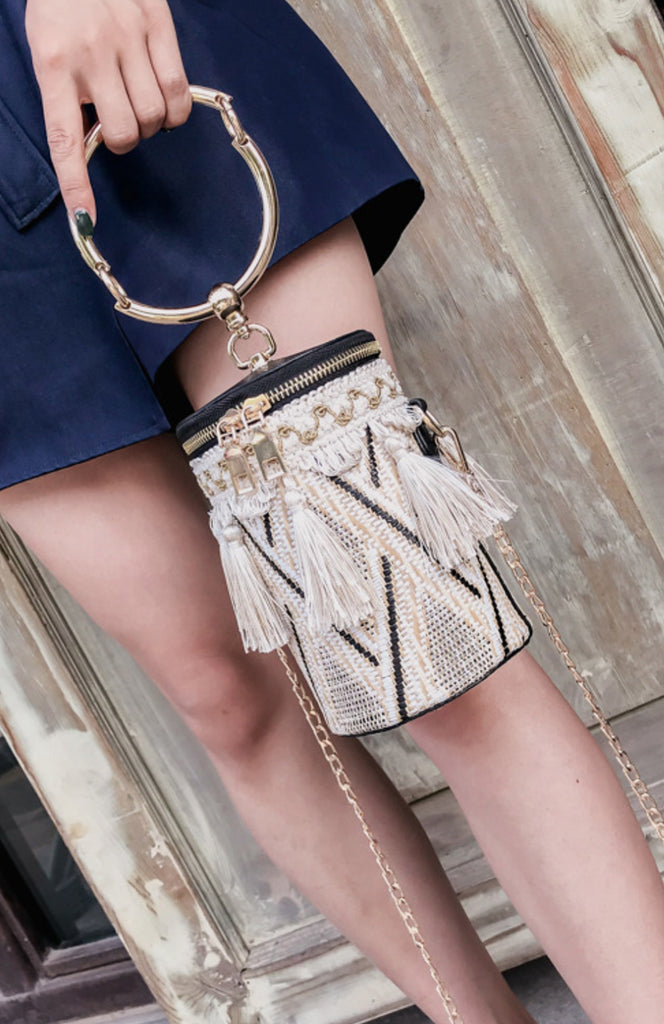 Rattan woven straw bucket hand bag with white and black tassels, gold handle and chain