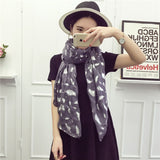 Lightweight feather print scarf