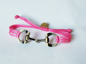 Brushed gold horse bit snaffle bracelet in leather string