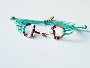 Rose gold horse bit snaffle bracelet in leather string