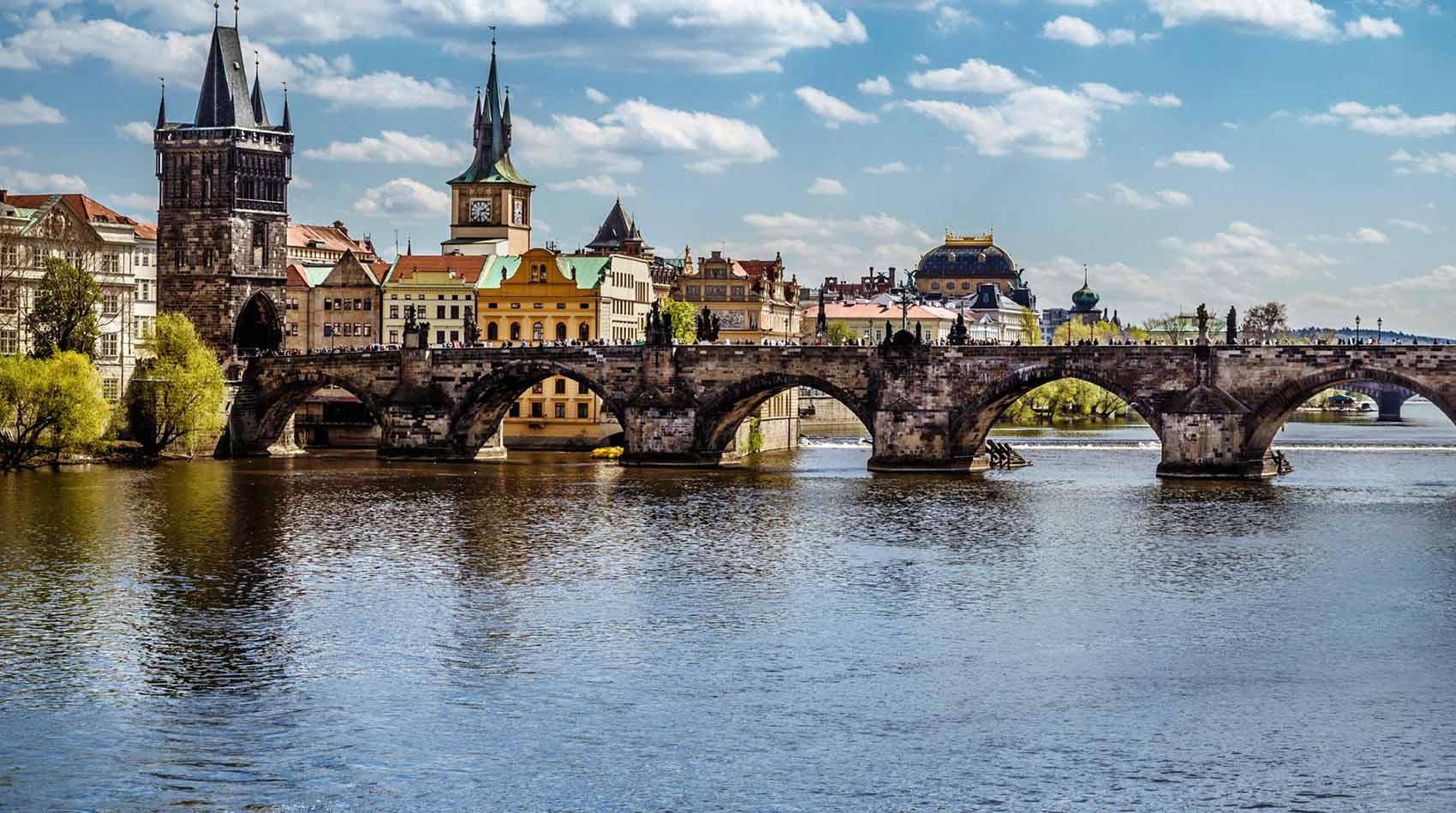 Prague now attracts more tourists than ever  But its picturesque downtown veils both a dark legacy and a resilient past  Dating back to about A D           Love Travel Co