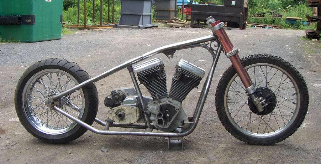 Custom bobber frame from MotoXcycle MXC uses wrought iron pieces from Heritage building in Westmount, Quebec Canada