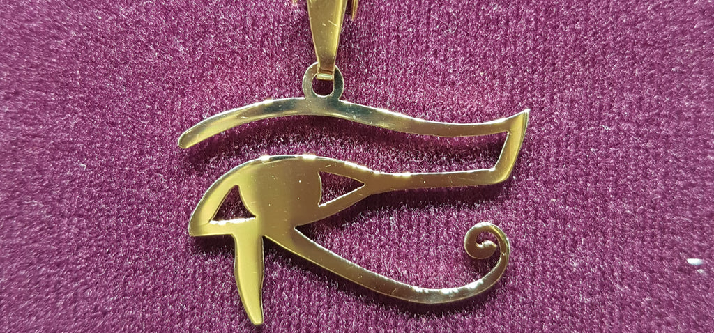 In the center: a custom made Egyptian Eye of Horus Pendant in 14 karat yellow gold with high polish finish made by Popular Jewelry